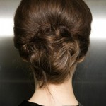 Hair is pinned to create soft detail